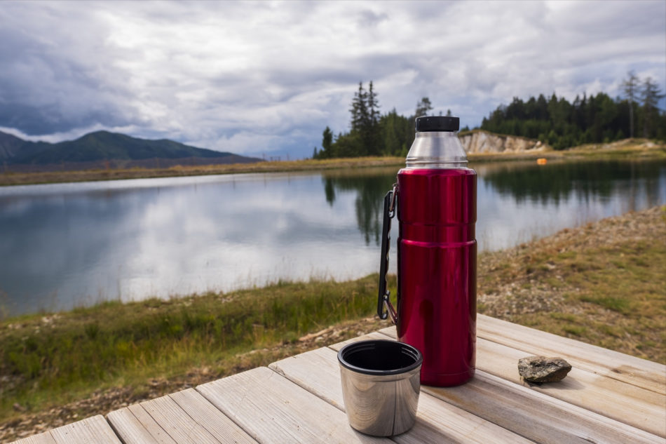 A flask by a lake