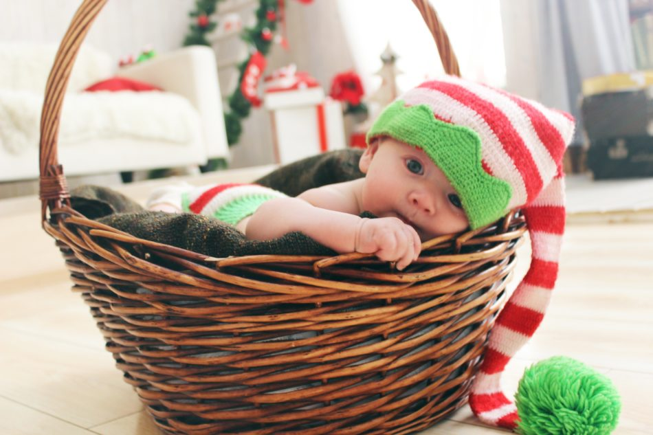 Adorable baby in a basket